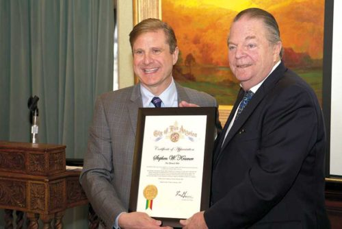 L.A. Controller Ron Galperin (left) presented a proclamation to Greater Miracle Mile Chamber of Commerce President Steve Kramer at a ceremony on Jan. 10 when Kramer received the Trailblazer Award. (photo by Chris Devlin)