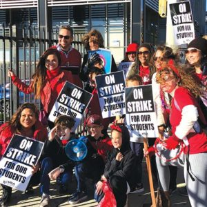 Teachers and students at West Hollywood Elementary picketed along the Sunset Strip one last time on Tuesday, hours before United Teachers Los Angeles and LAUSD administration ended the strike. (photo by Luke Harold)