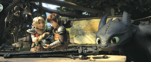 "Hiccup, Astrid and Toothless share a special moment in ""How to Train Your Dragon: The Hidden World."" (photo courtesy of Universal Pictures)"