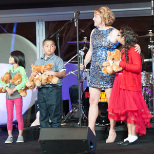 Mending Kids' Executive Director Isabelle Fox joined some of the children the organization helps at its annual gala at the Skirball Cultural Center. (photo by Bruce D. Kaplan/courtesy of Mending Kids)