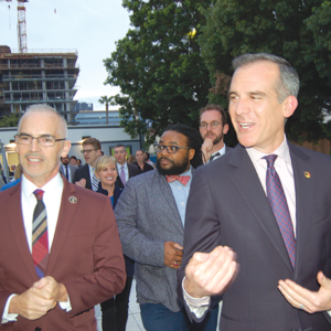 Mayor Eric Garcetti (right) and Councilman Mitch O'Farrell toured the new bridge housing facility in Hollywood on March 19 and said it will make an impact on homelessness in the area. (photo by Edwin Folven)