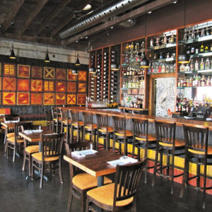 The interior of Los Balcones is warm and inviting and usually fills up with pre-theater patrons early, and stays open late for traditional Argentine diners. (photo courtesy of Los Balcones)