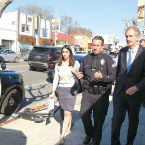 Los Angeles City Attorney Mike Feuer (right) walked Melrose Avenue with neighborhood prosecutor Nooshi Zahiri and Senior Lead Officer Ian O'Brien during a discussion Tuesday on crime prevention following multiple street robberies in the area. (photo by Edwin Folven)