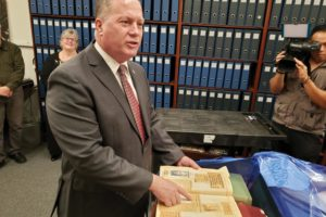 Los Angeles County Assessor Jeffrey Prang points out some of the highlights of the 20 journals he found in the basement of the Los Angeles County Hall of Administration. (photo by Cameron Kiszla)