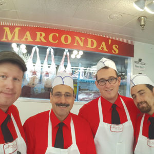 Marconda's Meats' Lou DeRosa and his sons contribute to the family atmosphere at the Original Farmers Market. (photo courtesy of the Original Farmers Market)