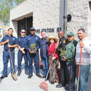 Firefighter Justin Braxton (left) joined Engineer James Czubek, Firefighter Viet Le, Windsor Square-Hancock Park Historical Society President Richard Battaglia, First-In Fire Foundation President Lyn MacEwen Cohen, Capt. Rick Crawford, and Jonathan Villaverde and Herberto Valle from GreenTree Landscaping at a recent project to improve the landscaping at Fire Station 61. (photo courtesy of Lyn MacEwen Cohen)