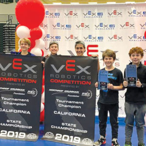 Student robotics teams from the Science Academy STEM Magnet school will compete in the upcoming VEX Robotics World championships in Kentucky. They include Dru Reed, Shai Haim and Hakop Zarikyan, of The Lab, and Nigel Peake and Zachary Rutten, of Stickman Robotics. (photo courtesy of LAUSD)
