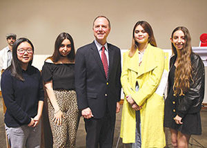 U.S. Rep. Adam Schiff (center) was joined at the student artwork exhibit by third place winner Jay Hee Kim (left), People's Choice award winner Melody Seraydarian, first place winner Bryanna Phimphachanh and second place winner Sierra Karr. (photo courtesy of Congressman Adam Schiff's office)