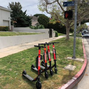 Scooters are required to be parked upright and within sidewalk furniture zones, such as the ones depicted. There are designated parking zones in downtown L.A., and more could be coming as communities adapt to the new devices. (photo by Karen Villalpando)