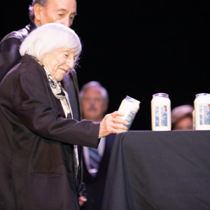 Holocaust survivor Marthe Cohn lit one of 18 memorial candles in honor of Israel's fallen soldiers at a Yom Hazikaron ceremony at the Saban Theatre. (photo courtesy of Positive Vibes Productions)