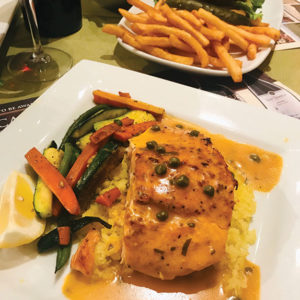 Besides Italian fare, the chefs at Maddalena Restaurant at the San Antonio Winery grill salmon and make a terrific vegetarian burger that is served with fries. (photo by Jill Weinlein)
