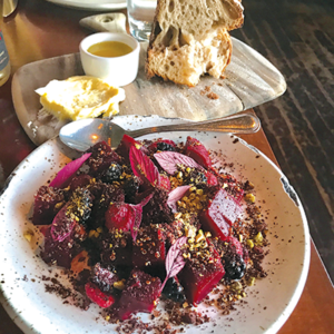 The beet, avocado and red quinoa salad at Rustic Canyon is sprinkled with pistachios and pistachio dirt. (photo by Jill Weinlein)