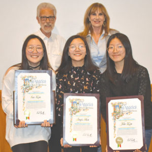 Fairfax High School students Sae Kim (left), Angie Shin and Jiho Kim received Irene Epstein Memorial Scholarships on May 16. They were joined by Dr. Howard Katzman, who works for the Aerospace Corporation and serves as education chairman of the Los Angeles Chapter of SAMPE, and Joan Pelico, chief of staff for Councilman Paul Koretz, 5th District. (photo by Patricia Katzman)