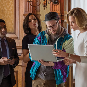 "Ravi Patel, June Diane Raphael, Seth Rogen and Charlize Theron star in the romantic comedy ""Long Shot,"" now playing in theaters. (photo by Philippe Bossé/courtesy of Lionsgate)"