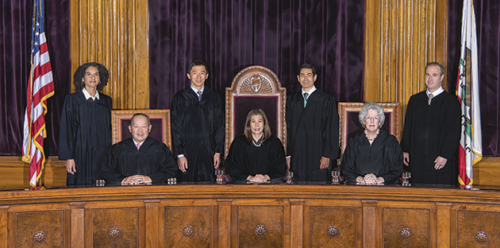 The California Supreme Court consists of (standing, from left) justices Leondra R. Kruger, Goodwin H. Liu, Mariano-Florentino Cuéllar and Joshua P. Groban; (from left, seated) Justice Ming W. Chin, Chief Justice Tani G. Cantil-Sakauye and Justice Carol A. Corrigan. (photo by Bob Knapik)