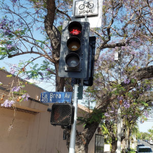 New signals at the intersection of Rosewood and La Brea avenues aim to make crossing safer for cyclists and pedestrians. (photo by Cameron Kiszla)