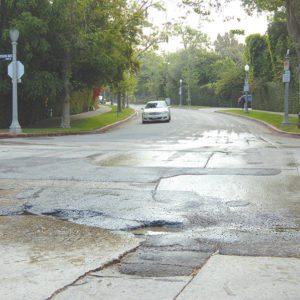 More funds have been earmarked for concrete street repair in the city's new budget, including in areas such as Hancock Park. (photo by Edwin Folven)