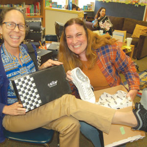 Hancock Park Elementary School Principal Ashley Parker (left) and third grade teacher Jill Kalbrosky showed off the shoes they selected as part of a donation by Sportie LA and Ccilu Footwear. (photo by Edwin Folven)