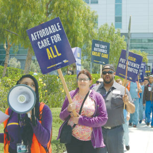 Demonstrators rallied outside Kaiser Permanente Medical Center on Sunset Boulevard Tuesday during a protest organized by SEIU-United Healthcare Workers West. (photo by Edwin Folven)