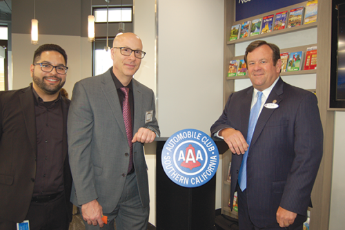 John Boyle (right), president and CEO of the Automobile Club of Southern California, was joined by Arturo Salome (left), business development manager of branch operations for AAA, and Paul Polacek, manager of the AAA's new Miracle Mile branch, at a celebration of the new office on Wilshire Boulevard. (photo by Edwin Folven)