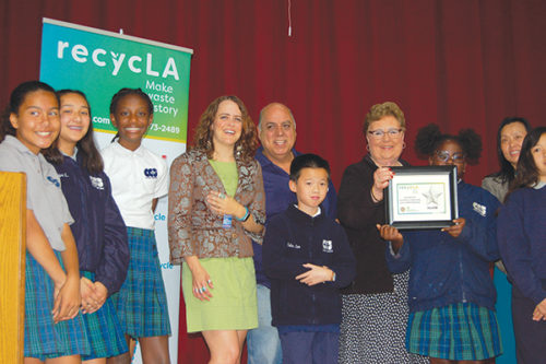 Cathedral Chapel School Principal Tina Kipp displayed a silver star certificate the school received for recycling at a ceremony on June 4. (photo by Edwin Folven)