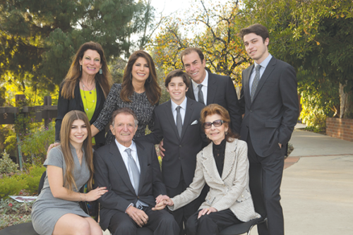 Melinda Goldrich (standing, left) and Andrea Goldrich Cayton (standing, second from left) have donated $10 million in honor of their late father, Jona Goldrich (seated, center), to establish the Jona Goldrich Center for Alzheimer's and Memory Disorders. (photo courtesy of the Goldrich family)