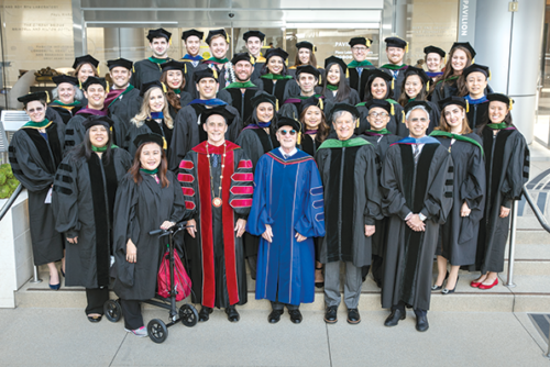 Cedars-Sinai's class of 2019 poses with faculty and Cedars-Sinai President and CEO Thomas Priselac, in red regalia; Nobel Laureate Randy Schekman, in blue; Dean of the Medical Faculty Shlomo Melmed; and Vice Dean of Research and Education Dr. Ravi Thadhani. (photo courtesy of Cedars-Sinai Medical Center)