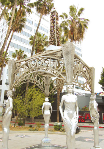 The missing Marilyn Monroe statue was perced atop the replica radio tower above the artwork/gazebo at Hollywood Boulevard and La Brea Avenue. (photo by Edwin Folven)