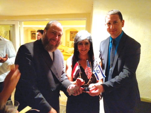 Ezra Friedlander, Lamia Mekhemar, ambassador of Egypt, and H.E. Eitan Weiss, consul general of Israel, were among the speakers. (photo courtesy of the Friedlander Group)