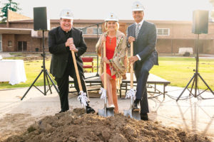 Father Gregory M. Goethals (left), president of Loyola High School of Los Angeles, was joined by the school's Vice President for Advancement Lela Diaz and Loyola Board Chairman Rick Caruso at a groundbreaking celebration for a new project transforming the campus. (photo by Brandon Bibbins)