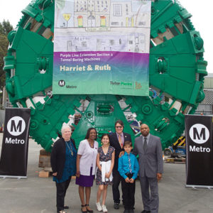 Two students joined Beverly Hills Mayor John Mirisch and representative from Metro and the city and county of Los Angeles to unveil their winning entries in Century City, where a new station will be built. (photo courtesy of Metro)