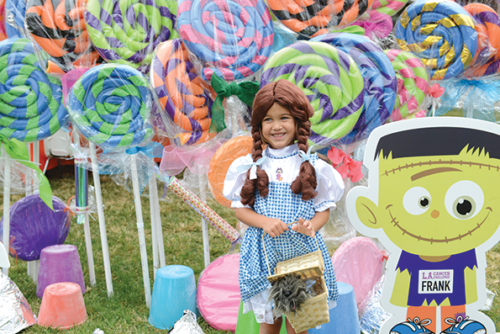 At the L.A. Cancer Challenge 5K Walk/run, the Candyland Kids Zone features life-size décor, including colorful lollipops and gum drops, as well as bounce houses and fun Halloween activities. (photo by Angela Daves-Haley)