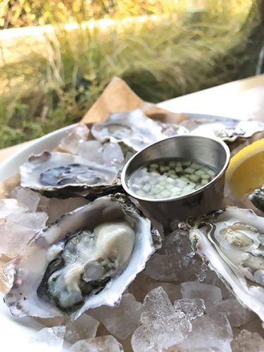 The oysters at Commerson during happy hour are just $1 each and come with a tangy cucumber mignonette. (photo courtesy of Commerson)