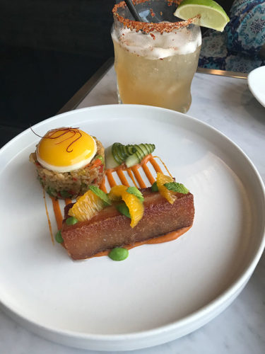 The elegant and artistically prepared dishes at LN2, such as the tender pork belly served with fried rice and topped with an egg, depict the chef's favorite flavors. (photo by Jill Weinlein)