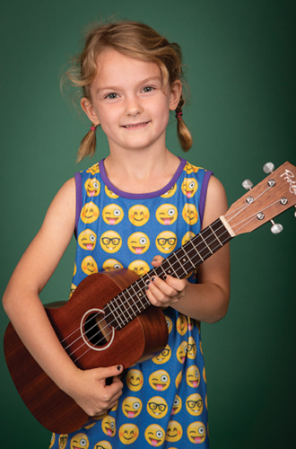 Rhodes student Halle B. and her ukulele. (photo courtesy of Rhodes School of Music)