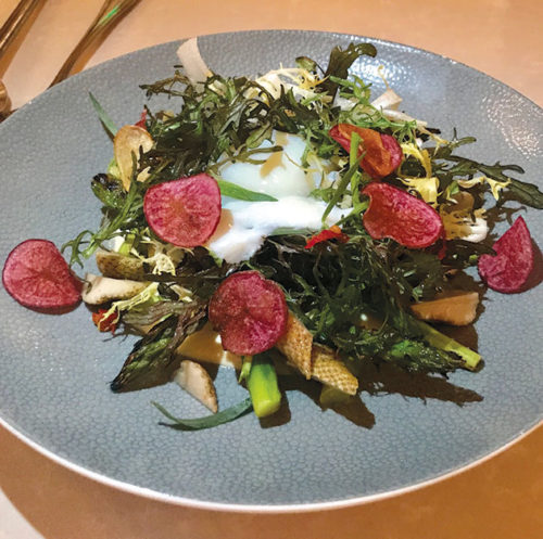The grilled asparagus salad is loaded with green strawberries, crispy fingerlings, tarragon, calabrese aioli and topped with a coddled egg – a bright dish perfect for a summer day. (photo by Jill Weinlein)