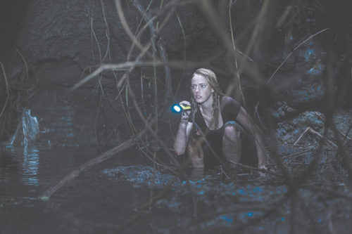 """Kaya Scodelario, as Hayley, is the heroine in """"Crawl,"""" a fun new horror film that can help audiences beat the summer doldrums.   (photo courtesy of Paramount Pictures)"""