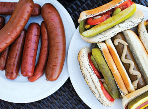 """Chicago-style hot dogs are traditionally steamed and placed on a poppy seed bun, then """"dragged through the garden."""" (photo courtesy of Vienna Beef)"""
