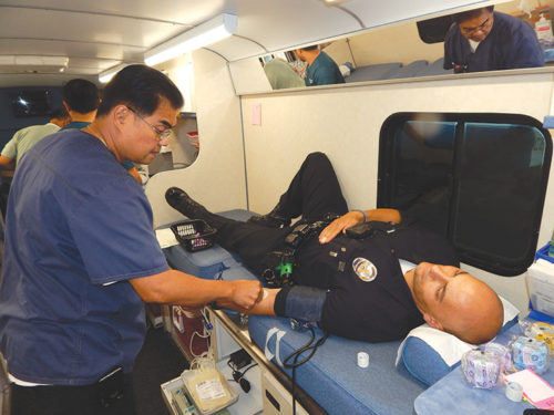 Officers from the Hollywood Division donated blood at a previous LAPD Operations West Bureau blood drive, which is part of an annual competition held by Cedars-Sinai Medical Center. (photo by Edwin Folven)