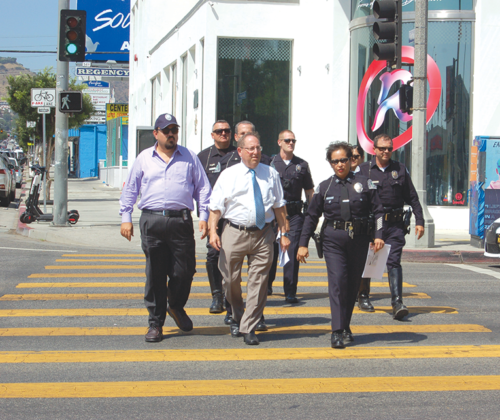 Los Angeles City Councilman Paul Koretz discussed safety issues involving e-scooters with Capt. Elaine Morales, of the LAPD's West Traffic Division, and other police officials. (photo by Edwin Folven)