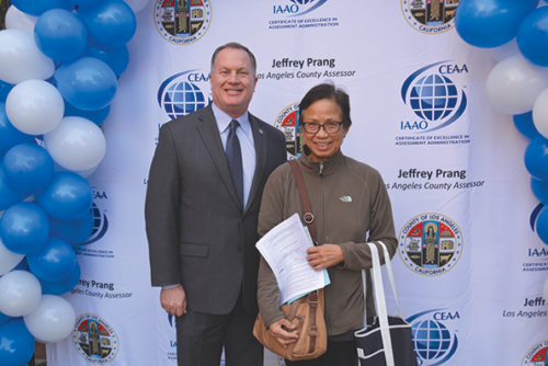 Los Angeles County Assessor Jeff Prang joined a homeowner from El Monte to celebrate record savings on property tax bills. (photo courtesy of the Los Angeles County Assessor's Office)