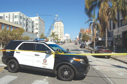 Police closed Wilshire Boulevard on Aug. 12 while they investigated an assault on a police officer that occurred near Detroit Street. (photo by EdwinFolven)