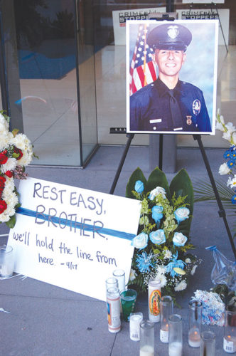 A memorial for Officer Juan Diaz was placed at LAPD headquarters. (photo by Edwin Folven)