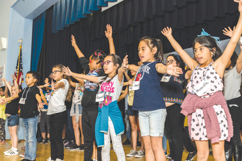 """Students star in shows such as """"Aladdin KIDS"""" and learn about theatrical production during the Center Theatre Group' annual Disney Musicals in Schools program. (photo by Hal Banfield)"""