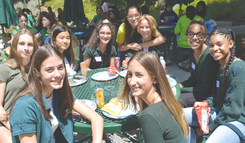 Dressed in green to represent their freshman status, members of the class of 2023 made new friends at lunch during Immaculate Heart High School's orientation program. (photo by Annie Taylor)