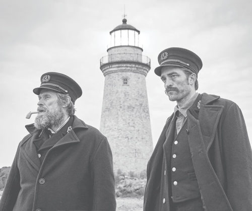 "Willem Dafoe stars as Thomas Wake, and Robert Pattinson as Ephraim Winslow, in ""The Lighthouse,"" a film by Robert Eggers about two lighthouse caretakers on a remote New England island in the 1890s. (photo courtesy of A24)"