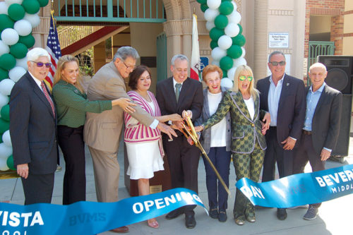 Beverly Hills Union School District Board of Education members, along with Beverly Hills City Councilmembers, cut the ribbon following the official opening of Beverly Vista Middle School on Monday. (photo by Ryan Mancini)
