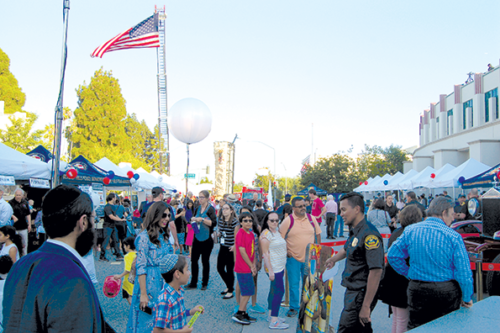 Hundreds of people attended the National Night Out festivities in Beverly Hills. (photo by Ryan Mancini)