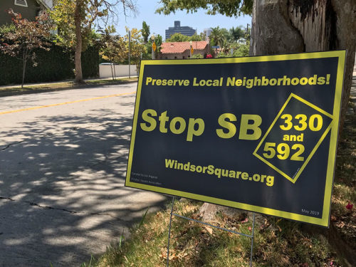 Lawn signs opposing SB 330 and SB 592 dot several streets near Windsor Square, including this one located on Sixth Street. (photo by Ryan Mancini)