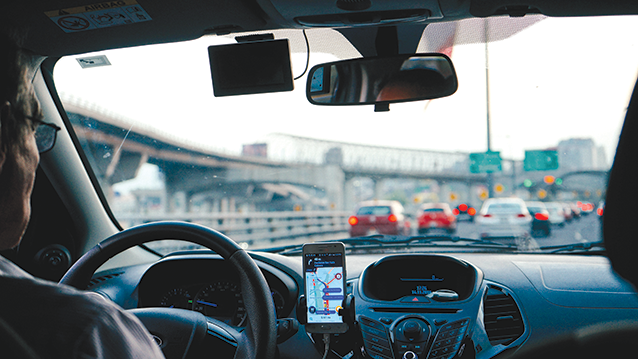 Drivers for ride-hailing companies like Uber and Lyft will be affected by California's Assembly Bill 5.  (photo by Dan Gold/courtesy of Unsplash)